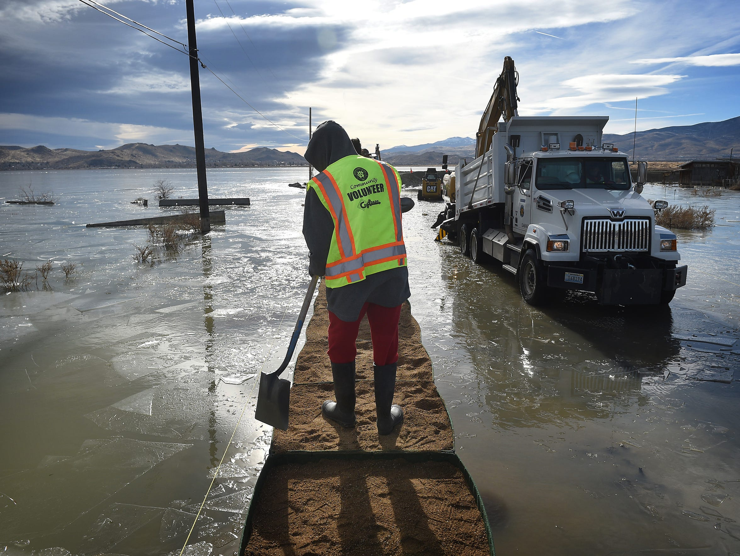 Washoe County sets up barriers on the edge of Swan Lake floodwaters in Lemmon Valley on Dec. 19, 2017.