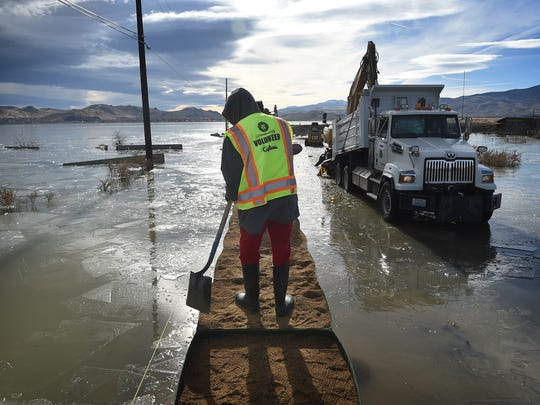 Washoe County sets up some HESCO barriers on the edge of Swan Lake flood waters in Lemmon Valley on Dec. 19, 2017.