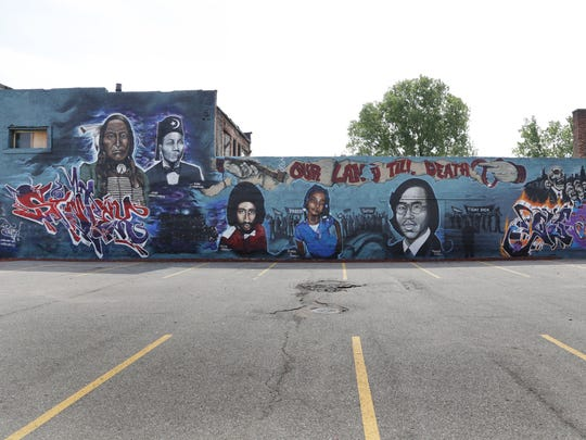 """Our Land Till Death"" by Sintex at 4731 Grand River in Detroit."