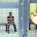 Dinesh Kumar, an undocumented migrant from India sits in a detention center at the Dennis DeConcini Port of Entry in downtown Nogales waiting to be processed after arriving at the Arizona border and asking for political asylum. Kumar, a from Punjab, is part of a surge of Indians asking for asylum at Arizona border.