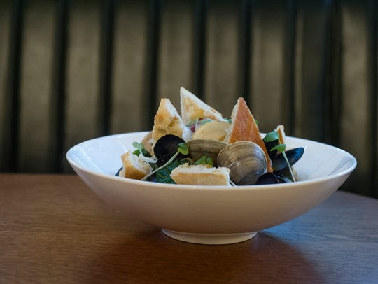 A mussels and clams appetizer is displayed after being
