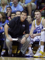 UCLA head coach Steve Alford and UCLA guard Bryce Alford, right, look on in the first half during an NCAA college basketball game against Kansas in the second round of the Maui Invitational, Tuesday, Nov. 24, 2015, in Lahaina, Hawaii.  (AP Photo/Rick Bowmer)