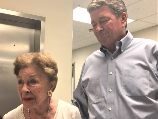 Mary Haskins and her son, Steve Haskins, speak after