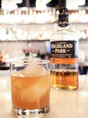 """Pullman's """"Flannel Shirt"""" cocktail is seen on Tuesday, Nov. 24, 2015. The drink is made with Highland Park whisky, apple cider, Cocchi Rouge, all spice, Angostura and lemon."""