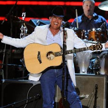 LAS VEGAS - APRIL 19:  Musician George Strait performs onstage during Brooks & Dunn's The Last Rodeo Show at MGM Grand Garden Arena on April 19, 2010 in Las Vegas, Nevada.  (Photo by Ethan Miller/Getty Images)