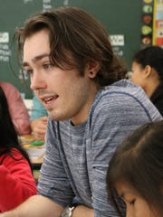 UVm senior Nicholas Palmer teaches Mandarin to Sustainability Academy students on June 7, 2017.