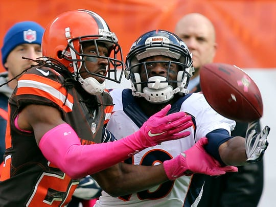 Denver Broncos wide receiver Emmanuel Sanders (10) cannot make the catch under pressure from Cleveland Browns defensive back Tramon Williams (22) during the second half of an NFL football game, Sunday, Oct. 18, 2015, in Cleveland. (AP Photo/Aaron Josefczyk)