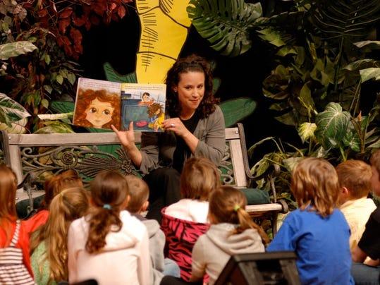 Clawson A&A Maria reading.jpeg