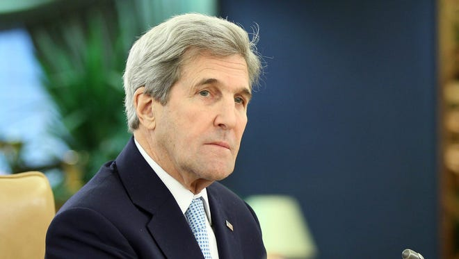 In this file photo, Secretary of State John Kerry says  construction of Jewish settlements threatens prospects for peace with the Palestinians. Kerry waits for the start of a meeting with delegates, at Riyadh's conference palace, in Riyadh, Saudi Arabia, Dec. 18, 2016.