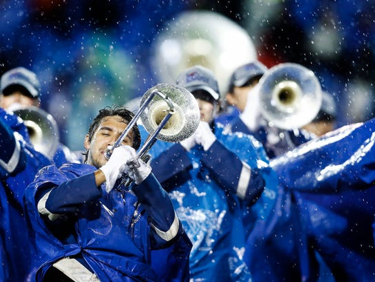 University of Memphis band members perform before action