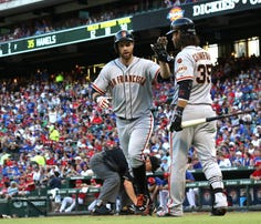 ARLINGTON, TX - AUGUST 1: Brandon Crawford #35 of the San Francisco Giants congratulates Brandon Belt #9 for hitting a home run in the third inning against the Texas Rangers at Globe Life Park in Arlington on August 1, 2015 in Arlington, Texas.