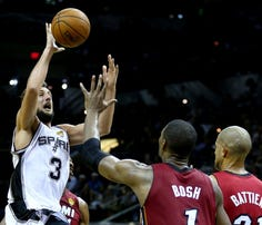 SAN ANTONIO, TX - JUNE 05:  Marco Belinelli #3 of the San Antonio Spurs goes to the basket against Chris Bosh #1 of the Miami Heat during Game One of the 2014 NBA Finals at the AT&T Center on June 5, 2014 in San Antonio, Texas.