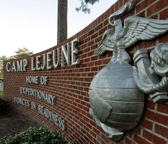 Cars enter the main gate at Camp Lejeune in Jacksonville, N.C.