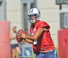 Jul 31, 2015; Nashville, TN, USA; Tennessee Titans Marcus Mariota (8) looks to pass during his first day of training camp at Saint Thomas Sports Park. Mandatory Credit: Jim Brown-USA TODAY Sports