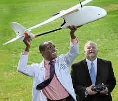 Pathologist Timothy Amukele, left, and Robert Chalmers are some of the engineers who created the drone blood courier system.
