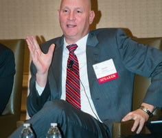 DISA CTO Dave Mihelcic speaks at an AFCEA DC event in January 2015.
