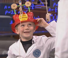 8-year-old Andrew Burton from Littleton shows off his invention: the Back Scratcher 2.0.