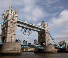 LONDON, ENGLAND - JUNE 27:  A giant set of Olympic rings are displayed from Tower Bridge on June 27, 2012 in London, England. The rings weigh over three tonnes and measure over 25 metres wide by 11.5 metres tall; they will be illuminated in a light-show every evening during the Games.  (Photo by Oli Scarff/Getty Images)