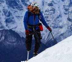 Then-Master Sgt. Karim Mella, atop Everest in 2011.