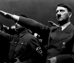 """A picture dated 1939 shows German Nazi Chancellor Adolf Hitler giving the nazi salute during a rally next to """"Deputy Furhrer"""" Rudolf Hess. AFP PHOTO / FRANCE PRESSE VOIR (Photo credit should read -/AFP/Getty Images)"""