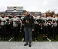 Army head coach Jeff Monken stands with players during the alma mater on Nov. 1 after their 23-6 loss to Air Force in an NCAA college football in West Point, N.Y.