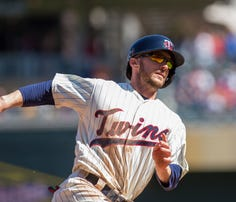 Apr 29, 2015; Minneapolis, MN, USA; Minnesota Twins center fielder Shane Robinson (21) rounds third in the ninth inning against the Detroit Tigers at Target Field. The Detroit Tigers beat the Minnesota Twins 10-7.