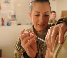A surgery medical technician administers a vaccine to a soldier in Afghanistan. Five of Military Times' Best for Vets: Colleges told us about their accelerated programs for medics or corpsmen to become registered nurses.