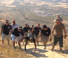 Wounded Marine crawls up First Sergeants Hill to honor fallen brothers