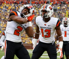 Sep 12, 2015; Ann Arbor, MI, USA; Oregon State Beavers wide receiver Hunter Jarmon (2) celebrates his touchdown with Oregon State Beavers wide receiver Jordan Villamin (13) in the first quarter against the Michigan Wolverines at Michigan Stadium. Mandatory Credit: Rick Osentoski-USA TODAY Sports