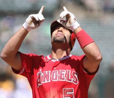 Los Angeles Angels designated hitter Albert Pujols (5) celebrates after hitting a two run home run against the Oakland Athletics during the second inning at O.co Coliseum.