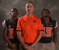 Jul 30, 2015; Burbank, CA, USA; Oregon State Beavers running back Storm Barrs-Woods (left), coach Gary Andersen (center) and cornerback Larry Scott at Pac-12 Media Day at Warner Bros. Studios. Mandatory Credit: Kirby Lee-USA TODAY Sports