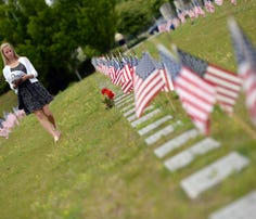 American flags mark the graves of fallen troops and veterans at the Rhode Island Veterans Memorial Cemetery in Exeter on Memorial Day in 2014.