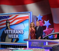 "Vanna While, left, and Pat Sajak are shown on the set of the television series ""Wheel of Fortune,"" honoring veterans for Veterans Day."