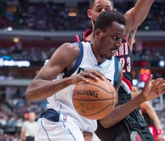 Apr 15, 2015; Dallas, TX, USA; Dallas Mavericks forward Al-Farouq Aminu (7) during the game against the Portland Trail Blazers at the American Airlines Center. The Mavericks defeated the Trail Blazers 114-98. Mandatory Credit: Jerome Miron-USA TODAY Sports