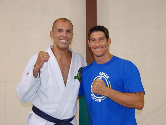 UFC legend Royce Gracie (left) poses with Gracie Downtown