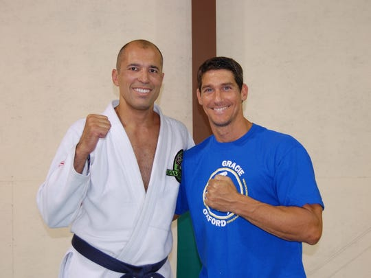 UFC legend Royce Gracie (left) poses with Gracie Downtown gym owner Tony Baker. Gracie will be holding a Brazilian jiu-jitsu seminar at the Gracie Downtown gym on Sept. 16.