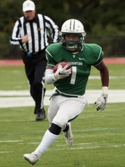 Delbarton runningback Andrew Sanders gains yardage vs Mt Olive during their football matchup. The Green Wave beat the Marauders 37-0. October 3, 2015, Morristown, NJ.