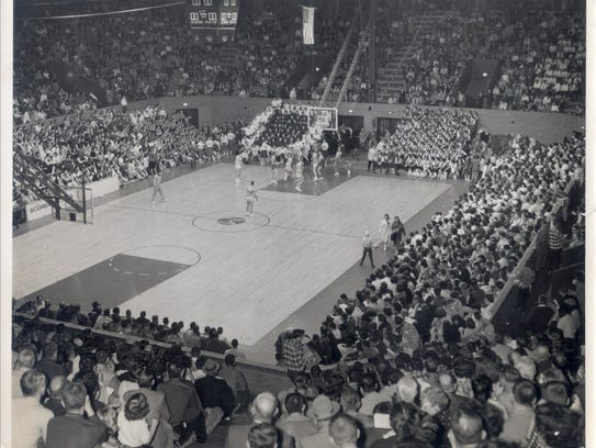 Eaton battles Harrison in a 1960 sectional game at