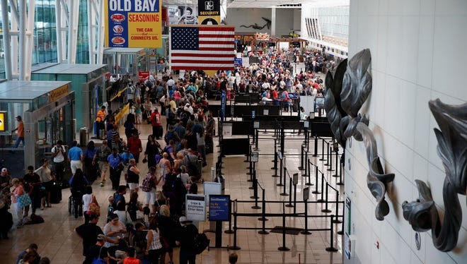 Travelers wait in line Aug. 15, 2015, at the Southwest check in at Baltimore/Washington International Thurgood Marshall Airport as flights are delayed due to technical issues at the Federal Aviation Administration.