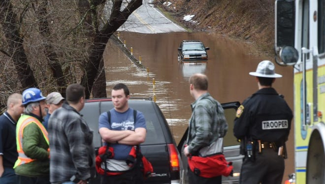 Emergency responders came to the rescue of a woman trapped in a car in floodwaters Thursday in Warrington Township.