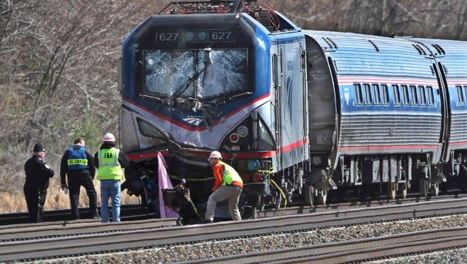 Amtrak investigators inspect a fatal train crash April 3, 2016, in Chester, Pa. The Amtrak train struck a piece of construction equipment just south of Philadelphia, causing a derailment.