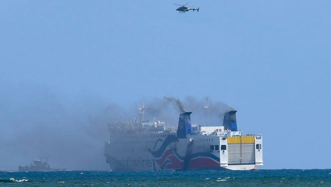 Smokes spills from the cruise ship Caribbean Fantasy off the coast of San Juan on Aug. 17, 2016.