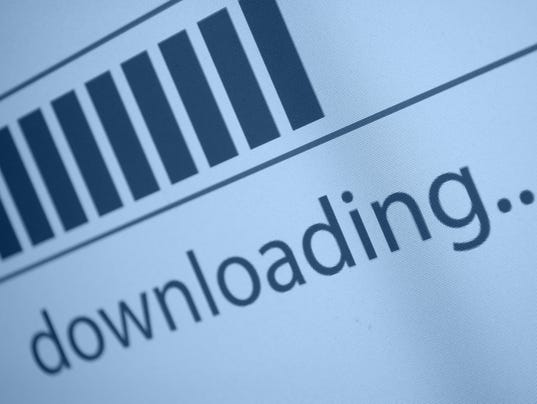 Close-up of downloading file on a computer screen