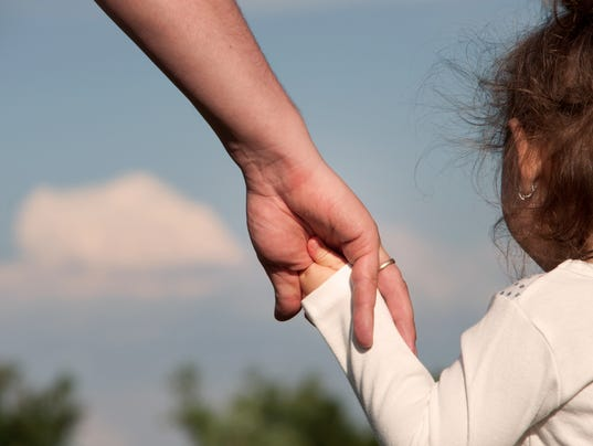 Father holds the hand of the daughter