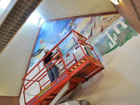 Photo mural work begins at oconomowoc library for Mural work using m seal
