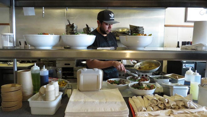 Doug Hernandez, chef and co-owner at Ojai Bowls, prepares multiple servings of the restaurant's best-selling braised beef bowl featuring Watkin's Cattle Co. beef.