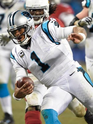 Carolina Panthers quarterback Cam Newton (1) runs the ball during the fourth quarter against the Arizona Cardinals in the NFC Championship football game at Bank of America Stadium. Mandatory Credit: John David Mercer-USA TODAY Sports