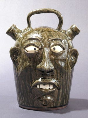 Face jugs like this one, by artist Wayne Hewell, will be at the Wish List show at American Folk Art.