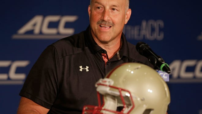 Boston College head coach Steve Addazio answers a question during a news conference at the Atlantic Coast Conference Football kickoff in Greensboro, N.C., Monday, July 21, 2014. (AP Photo/Chuck Burton)