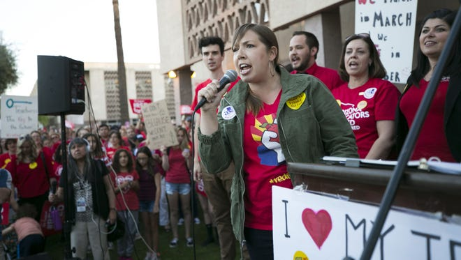 Rebecca Garelli, a seventh grade science teacher at Sevilla West School in Phoenix, speaks during a #RedForEd rally at the Arizona State Capitol in Phoenix on March 28, 2018.
